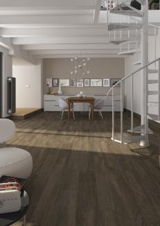 Escalera minimalista de ambiente de Vives con cerámica Paramo Noce