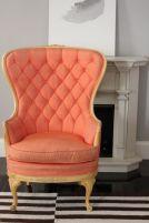 Butaca con tapizado capitoné en tela naranja