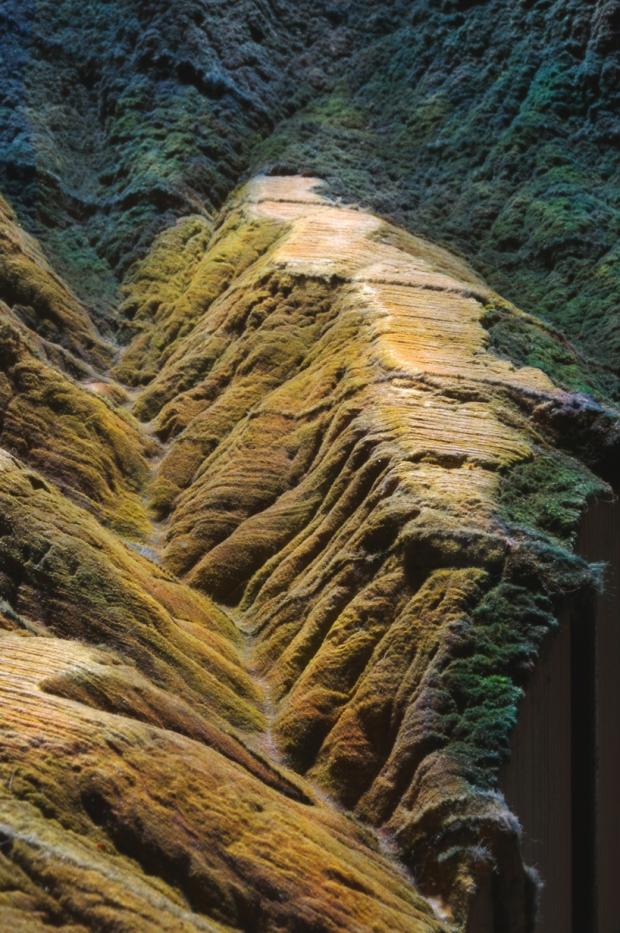 guy-laramée-carves-a-mountainscape-from-encyclopedias-designboom-04