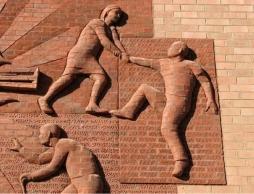 brick_sculpture_church_durham-640x480