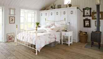 country-style-bedroom-with-metal-bed-and-wood-stove